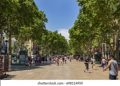 BARCELONA, SPAIN - JUNE 2017: The famous La Rambla street in Barcelona city, Spain. It is a street in central Barcelona, popular with tourists and locals alike of Barcelona city, Spain.