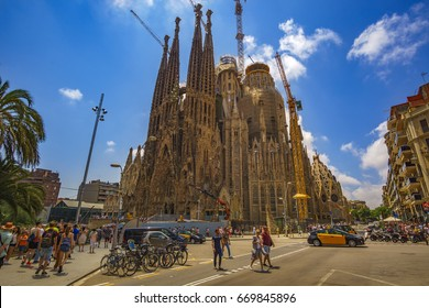 BARCELONA, SPAIN - JUNE 2017: Sagrada Família (Basilica and Expiatory Church of the Holy Family) is a large Roman Catholic church in Barcelona, designed by Catalan architect Antoni Gaudí.