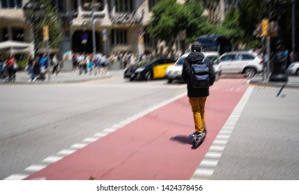 Barcelona, Spain. June 2019. Electric scooter riding in a street of Barcelona. EU cities like Barcelona have already prepared specific regulations since the use of these devices became a 'boom'