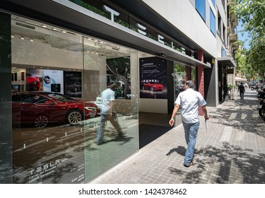 Barcelona, Spain. June 2019: Tesla inc cars flagship store near Passeig de Gracia luxury shopping street with Tesla logo and an electric cars model S and X inside