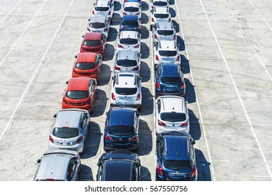 Barcelona, Spain - June 21, 2016: New cars of the Peugeot and Opel brand ready to ship in the port of Barcelona