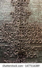 Barcelona, Spain, June 22 2019: Fragment of the Sagrada Familia basilica designed by Antonio Gaudi - one of the external doors with the prayer of Our Father in different languages
