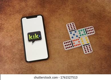 Barcelona, Spain - June 22, 2020; Kik Apps on a Vintage Paper with Domino Cards. Kik is an im mobile app by Kik Interactive. #kik