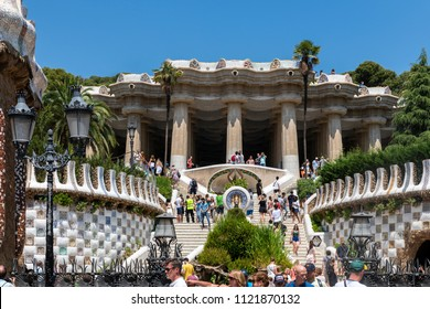 BARCELONA, SPAIN - JUNE 23, 2018: The staircase at the entrance of the park and Pavilions designed by Antoni Gaudi in Parc Guell. The Park is the biggest city tourist attraction.
