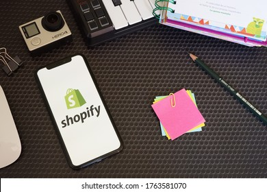 Barcelona, Spain - June 25, 2020; Shopify with Stationery and Action Camera. Shopify is a Canadian multinational e-commerce company.