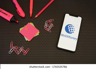 Barcelona, Spain - June 28, 2020; Webmoney App on a Black Table with Pink Stationery. WebMoney is an online payment settlement system. #WebMoney