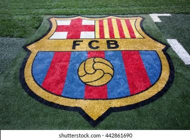 BARCELONA, SPAIN - JUNE 3, 2016. FC Barcelona logo at Camp Nou stadium field