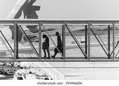 BARCELONA, SPAIN June 30, 2015: people walking through a gateway at barcelona airport