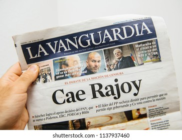 BARCELONA, SPAIN - JUNE 6 2018: Man holding La Vanguardia newspaper cover with Cae Rajoy translated as Mariano Rajoy goodbye when a vote of no confidence ousted his government