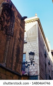 "Barcelona, Spain; June 8, 2017: Exterior wall of the Cathedral of Barcelona (""Capella de Santa LLùcia"" chapel), in the croissing point of the ""Carrer del Bisbe"" and ""Carrer de Santa LLùcia"" streets"