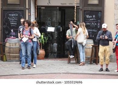 BARCELONA SPAIN - JUNE 9: At cafe sidewalk in Barcelona Spain on June 9, 2013. Barcelona is one of the most populated metropolitan areas in Europe