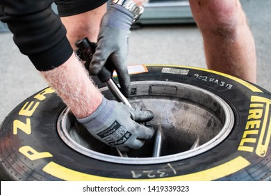 Barcelona, Spain - Mar 1st, 2019 - Haas F1 mechanic working on yellow medium Pirelli tyre during F1 2019 Pre-Season Test at Circuit de Catalunya.