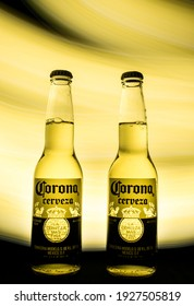 Barcelona, Spain March 02, 2021. Two bottles of Corona Mexican beer on a yellow and black background.