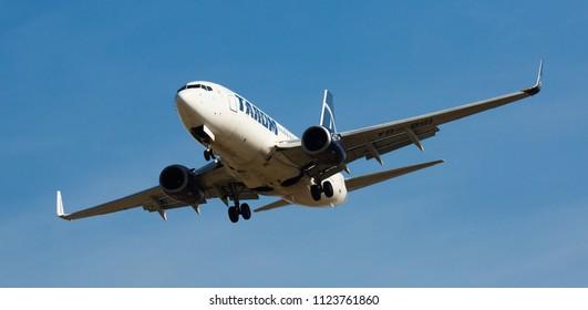 BARCELONA, SPAIN - MARCH 09, 2017:  Tarom Airlines plane landing in El Prat Airport on time. Barcelona, Spain