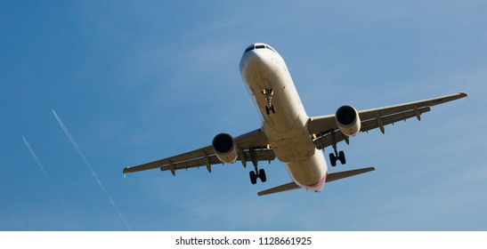 BARCELONA, SPAIN - MARCH 09, 2017:  Iberia Airlines plane arriving at El Prat Airport on schedule. Barcelona, Catalonia