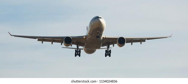 BARCELONA, SPAIN - MARCH 09, 2017:  Turkish Airlines plane landing in El Prat Airport on time. Barcelona, Spain