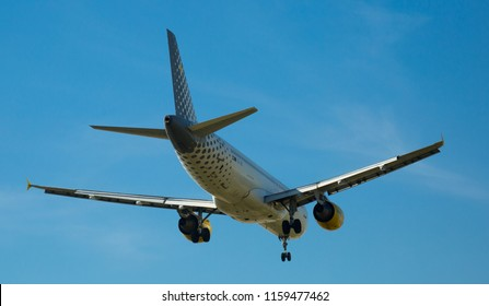BARCELONA, SPAIN - MARCH 09, 2017:  Vueling Airlines plane arriving at El Prat Airport on schedule. Barcelona, Catalonia