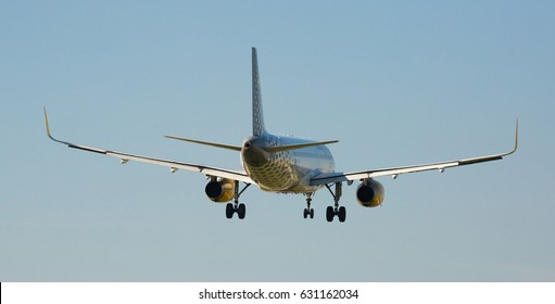 BARCELONA, SPAIN - MARCH 09, 2017:  Vueling Airlines plane landing in El Prat Airport on time. Barcelona, Spain