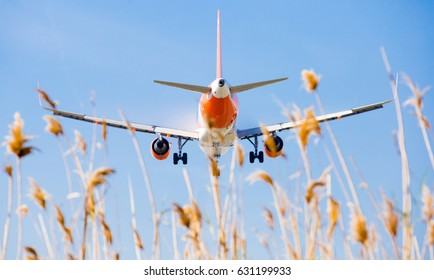 BARCELONA, SPAIN - MARCH 09, 2017:  EasyJet plane landing in El Prat Airport on time. Barcelona, Spain