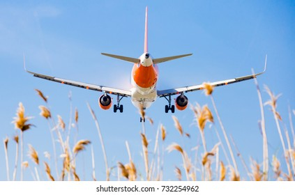 BARCELONA, SPAIN - MARCH 09, 2017:  EasyJet plane arriving at El Prat Airport on schedule. Barcelona, Catalonia