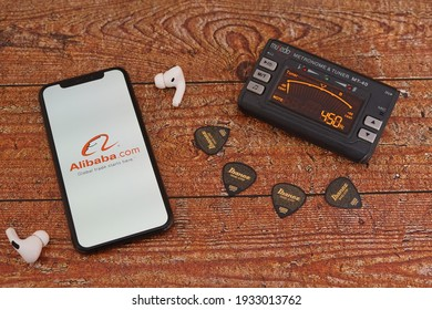 Barcelona, Spain - March 10, 2021: Alibaba Iphone Apps with Guitar Picks and Tuner.