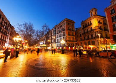BARCELONA, SPAIN - MARCH 13, 2014: Night view of Rambla in Barcelona