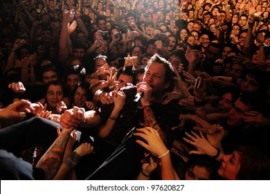 BARCELONA, SPAIN - MARCH 13: Pierre Bouvier, singer of Simple Plan band, surrounded by his fans, performs at Razzmatazz on March 13, 2012 in Barcelona, Spain.