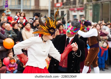 BARCELONA, SPAIN - MARCH 2, 2014: Dancing people at Carnival Balls to the Popular Culture and Traditional Catalan during La Taronjada