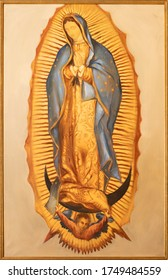 BARCELONA, SPAIN - MARCH 2, 2020: The painting of Virgin Mary of Guadaluppe in the church Santuario Nuestra Senora del Sagrado Corazon by unknown artist.