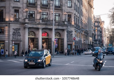 Barcelona, Spain. March 2018: People walking in front of H&M shop in Barcelona's city center. Consumerism concept.