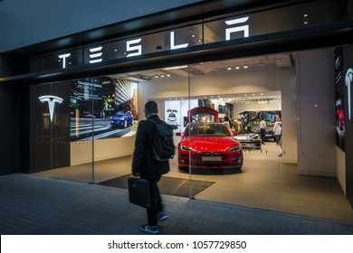 Barcelona, Spain. March 2018: Tesla inc cars flagship store near Passeig de Gracia luxury shopping street with Tesla logo and an electric cars model S and X inside