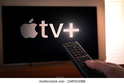 Barcelona, Spain. March 2019: Man holds a remote control With the new Apple TV+ screen on TV. Apple TV+ is an online video streaming subscription service. Apple TV plus is set to compete with other
