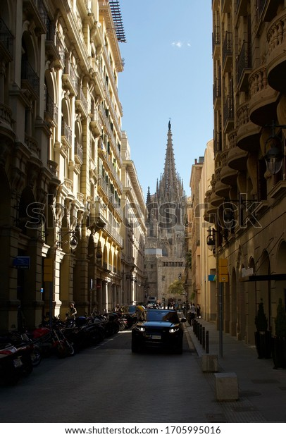 Barcelona, Spain, March 2020. Looking down a narrow street to the The Cathedral of the Holy Cross and Saint Eulalia, also known as Barcelona Cathedral.