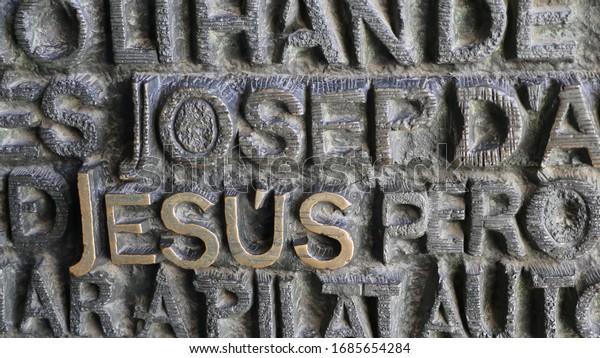 Barcelona, Spain, March 2020. The word Jesus is inscribed onto the door to the Sagrada de Familia in Barcelona.