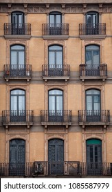 BARCELONA, SPAIN. March 22, 2015: Facade with windows of a historic building in the center of Barcelona, Spain. Four floors with balconies and wrought iron railings.