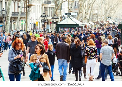 BARCELONA, SPAIN - MARCH 28: crowd of people  at La Rambla in March 28, 2013 in Barcelona, Spain. La Rambla one of symbol of city. Center of touristic life