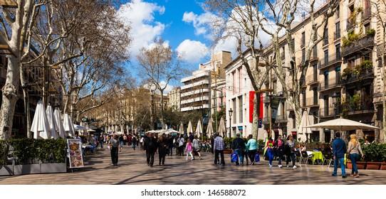 BARCELONA, SPAIN - MARCH 28: La Rambla in March 28, 2013 in Barcelona, Spain. La Rambla is street in central Barcelona, between El Raval and Barri Gotic districts