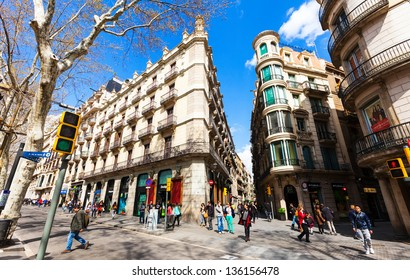 BARCELONA, SPAIN - MARCH 28: picturesque houses at La Rambla in March 28, 2013 in Barcelona, Spain. La Rambla one of symbol of city. Center of touristic life