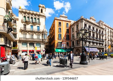 BARCELONA, SPAIN - MARCH 28: Picturesque houses at La Rambla in March 28, 2013 in Barcelona, Spain. Street in central Barcelona, between El Raval and Barri Gotic districts