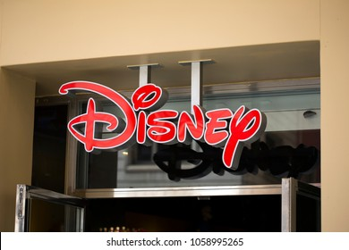 BARCELONA, SPAIN - March 29, 2018: Disney store front logo in Barcelona Gothic quarter. Walt Disney Company, commonly known as Disney, American diversified multinational mass media and entertainment