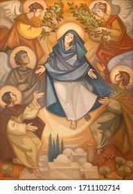 BARCELONA, SPAIN - MARCH 3, 2020: The modern painting of Assumption in the church Santuario Nuestra Senora del Sagrado Corazon by Navarro Perez Dolz (1990).