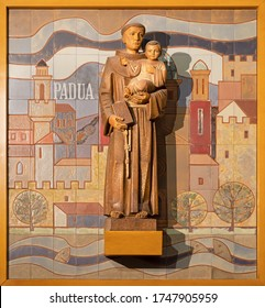 BARCELONA, SPAIN - MARCH 3, 2020: The carved modern statue of St. Anthony with the terracotta background in the chruch Iglesia de Belen.