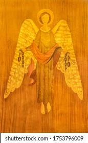 BARCELONA, SPAIN - MARCH 3, 2020: The intarsia of angel with the symbolic handcuffts in church Basilica de la Merced.