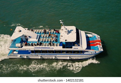 Barcelona, Spain - March 30, 2016: pleasure boat Visio submarina Trimar with people on deck in sea. Boat trip for pleasure. Travelling by sea on boat. Summer vacation holiday. Wanderlust on boat trip.