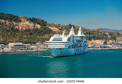 Barcelona, Spain - March 30, 2016: ocean liner GNV Rhapsody Genova in sea harbor at mountains. Cruise destination and liner trip. Summer vacation on liner. travelling discovery by sea liner.