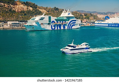 Barcelona, Spain - March 30, 2016: pleasure boat and cruise ships GNV, Grimaldi Lines in sea. Water transportation of pleasure boat. Travelling by sea on pleasure boat. Summer vacation
