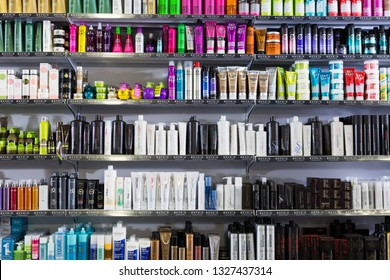 BARCELONA, SPAIN - MARCH 31, 2018: Shelves with different hair care products in a cosmetics store