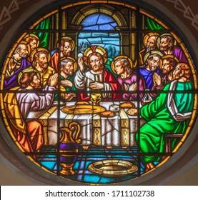 BARCELONA, SPAIN - MARCH 5, 2020: The modern fresco of Last supper in church Iglesia Sant Angel Custodi from 20. cet..