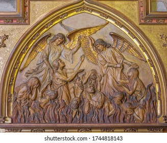 BARCELONA, SPAIN - MARCH 5, 2020: The relief of angels among the souls in the purgatory in the church Església de la Concepció from 19. cent.