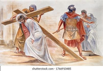 BARCELONA, SPAIN - MARCH 5, 2020: The fresco Simon of Cyrene helps Jesus carry the cross in the atrium of church Església de la Concepció from 19. cent.